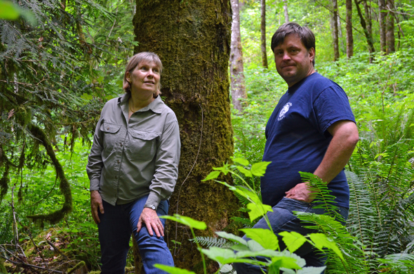 Ruth Foster (left) started the Mossom Creek Hatchery in 1976. Pictured here with hatchery supporter George Assaf. Photo by Carlos Tello.