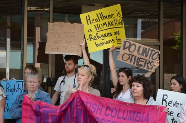 Health-care workers rallied outside the Canadian Citizenship and Immigration office in Vancouver.